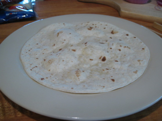 lightly heated tortilla for pizza