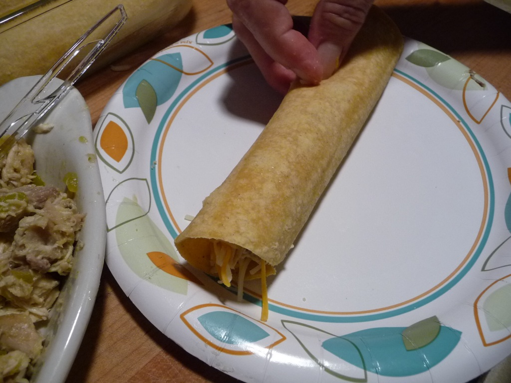 roll corn tortilla tightly