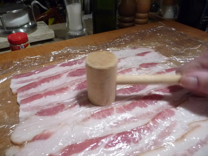 Gently pound bacon strips to bind together and form mat