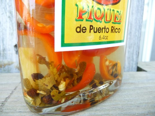 Chunks of habaneros in bottle of Pique mi Madre