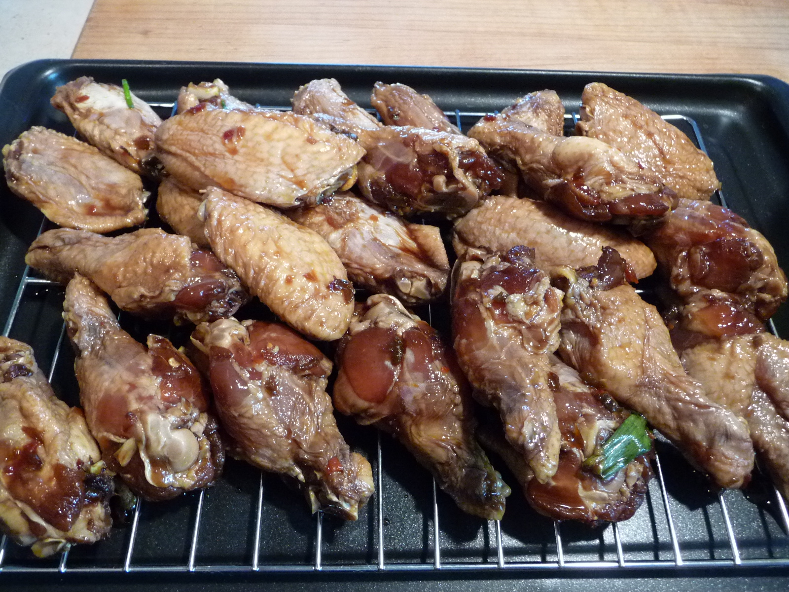 Remove wings from marinade and let drain slightly.
