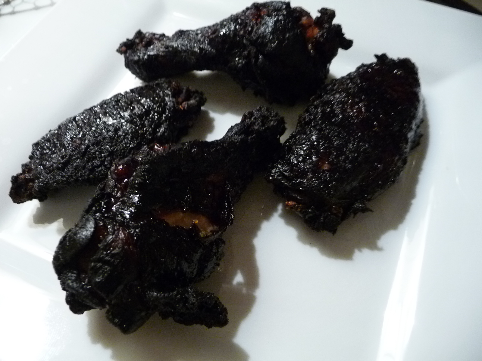 Coal black wings fried crispy with no sauce