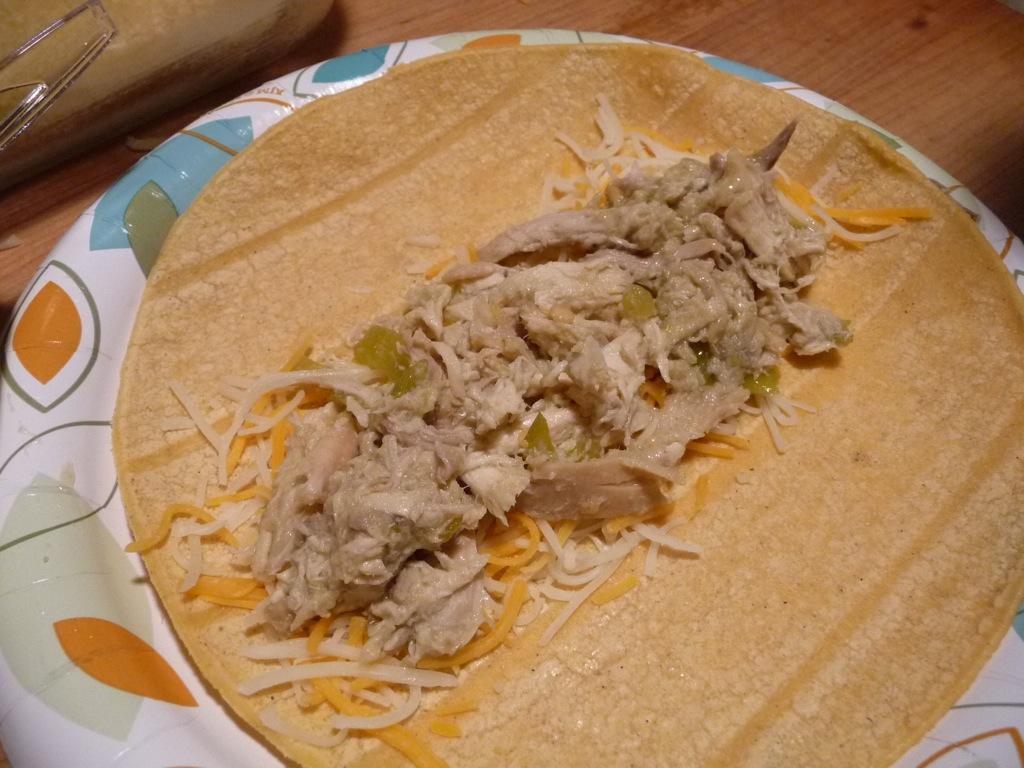spoon shredded chicken mixture onto corn tortillas