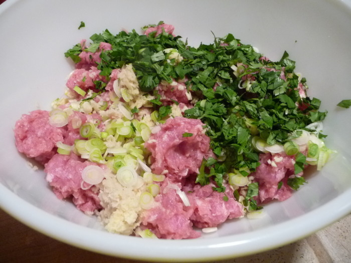 add dry ingredients - grated ginger, garlic, scallions, cilantro